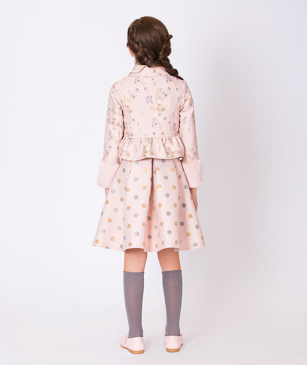 Back of girl in pink flower embroidered coat and polka dot pink skirt for girls