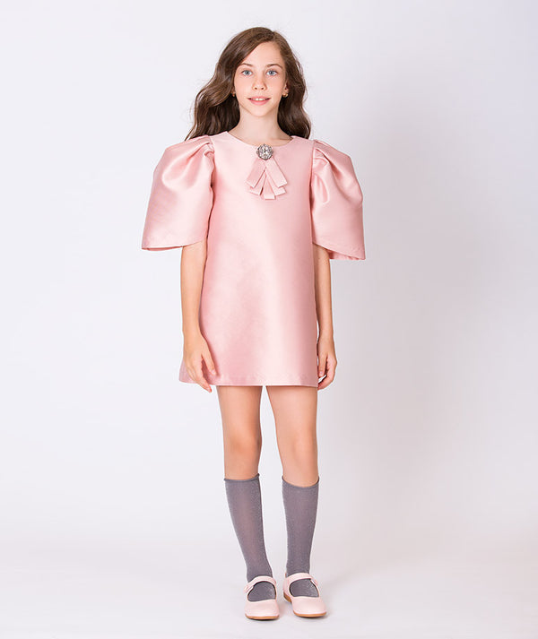 Girl in pink taffeta dress with puffy shoulders and brooch for kids