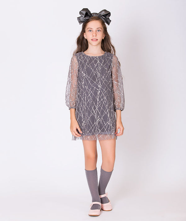 Girl in gray sequined party dress for kids