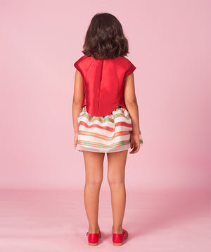Back of girl in red blouse and striped skirt for kids by Mama Luma