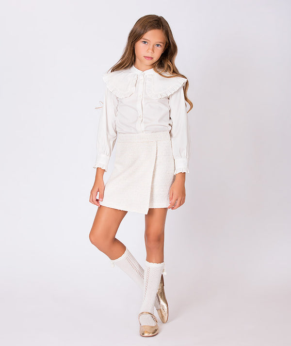 Girl in luxury white blouse and chic skirt for kids