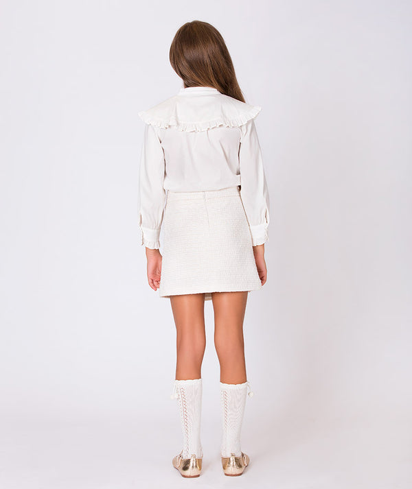 Back of girl in luxury white blouse and chic skirt for kids