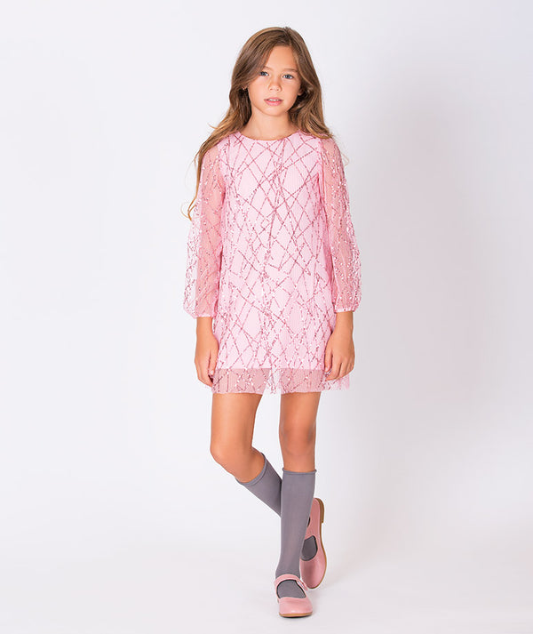 Girl in pink party dress for kids