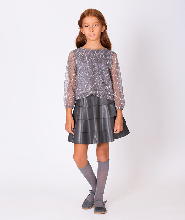 Girl in sheer gray blouse for kids with pleated gray party skirt for kids