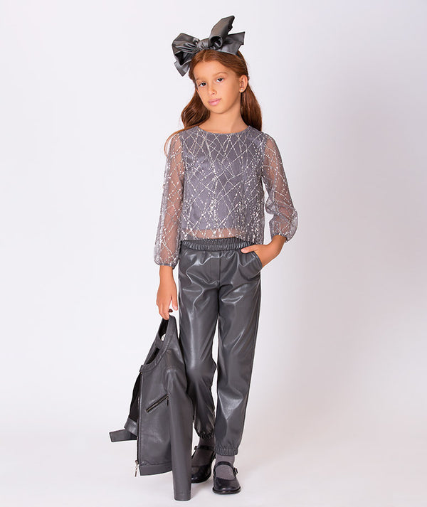 Girl in gray sequin sheer party blouse for kids and shiny gray pants for kids