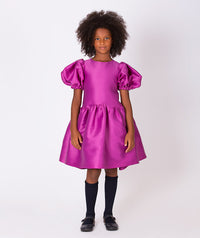 Girl in magenta flared dress with balloon shoulders for kids