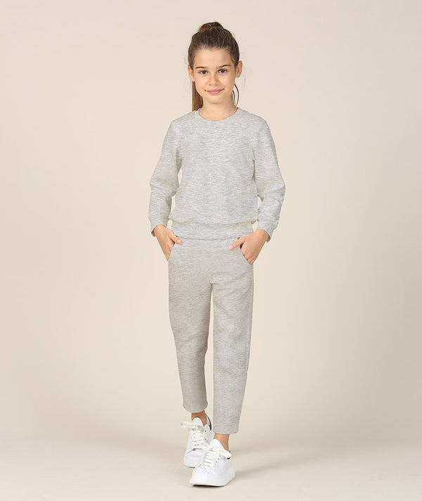 Girl in gray athleisure tracksuit by Mama Luma