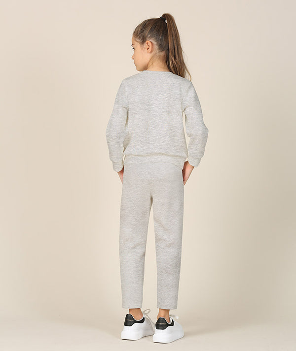 Back of girl in gray athleisure track suit by Mama Luma