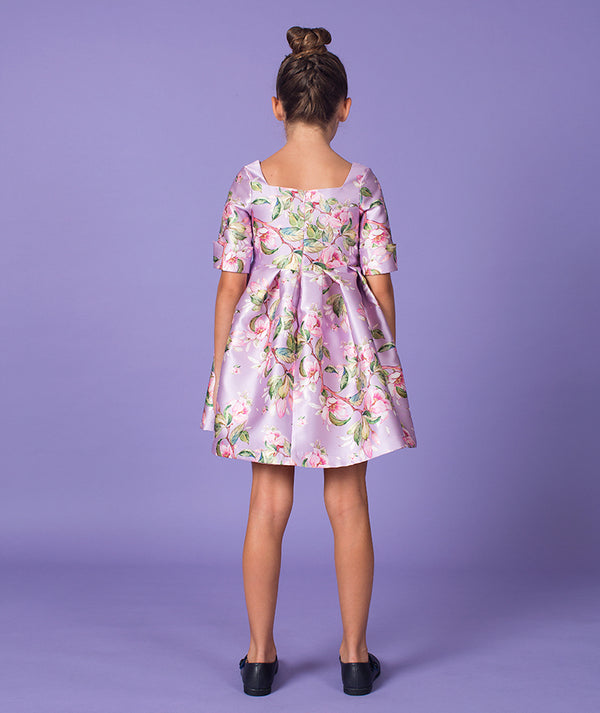 Back of girl in lilac flower print party dress by Mama Luma