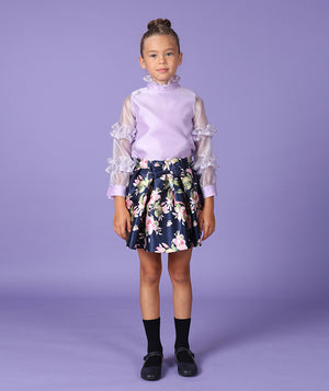 Girl in lilac blouse and designer flower print skirt for kids by Mama Luma