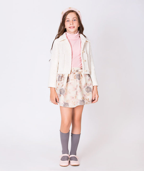 Girl in cotton pink turtle neck, white collared button-up jacket, and beige flower print skirt for girls by Mama Luma