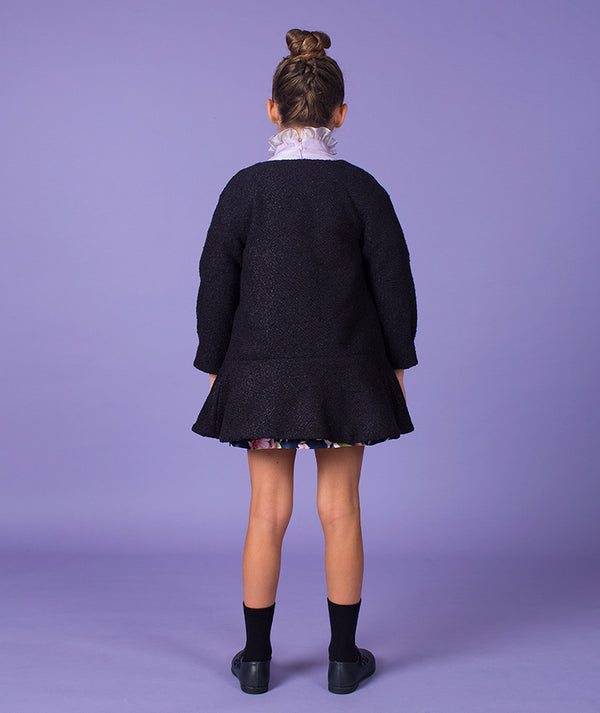 Back of girl in Navy Blue coat and lilac princess dress by Mama Luma