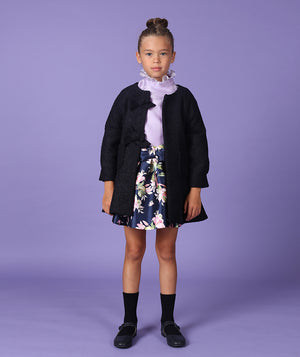 Girl in chic outfit for kids and navy blue jacket for kids by Mama Luma