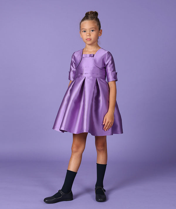 Girl in purple special occasion dress for kids
