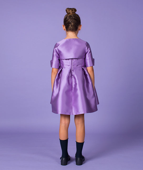 Back of girl in purple special occasion dress for kids