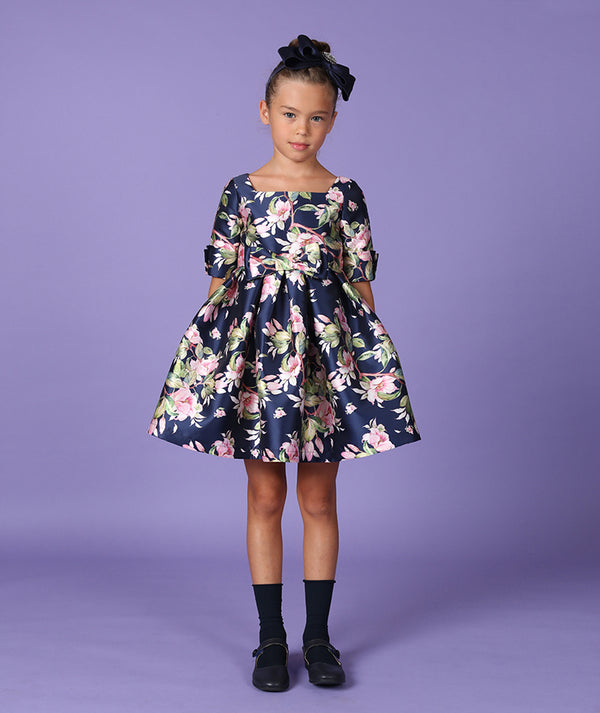 Girl in navy blue flower print flared party dress for kids by Mama Luma