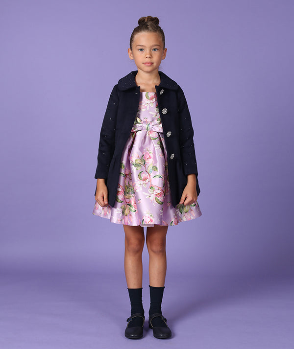Girl in lilac floral print with bow and navy blue designer coat for kids
