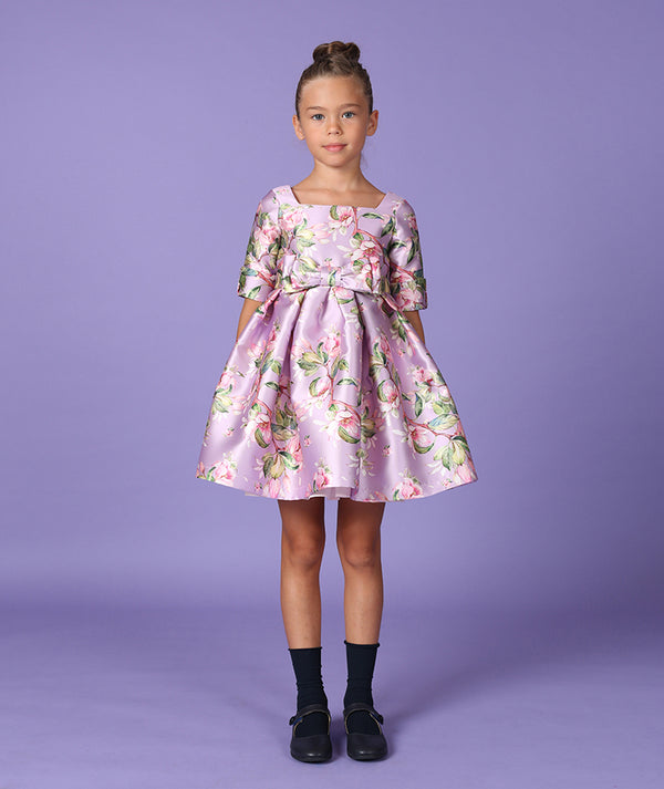Girl in flower print lilac dress for toddlers by Mama Luma
