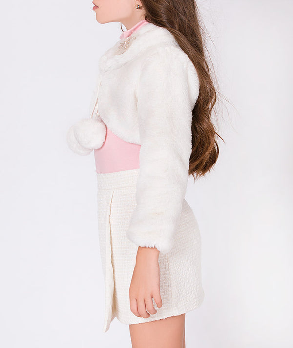 Girl in pink crepe nice blouse for kids with pleated white special occasion skirt and fur white jacket for kids