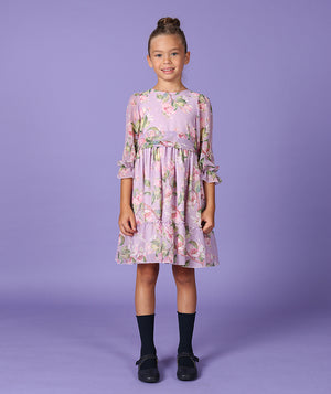 Girl in lavender flower print dress for kids