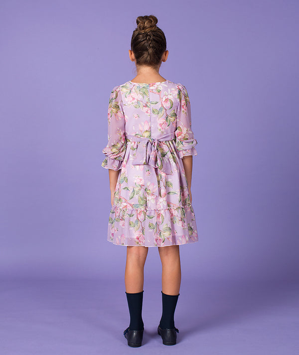 Back of girl in lilac floral print Mama Luma dress