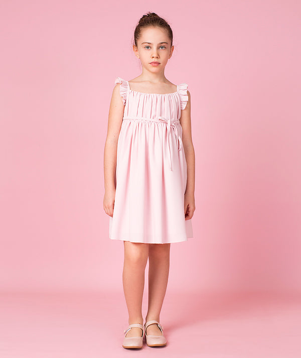 Girl in pink cotton dress for kids