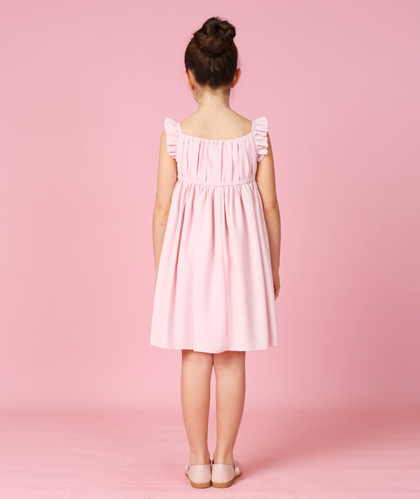 Back of girl in pink cotton dress for kids