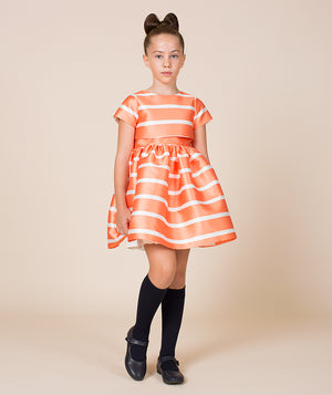 Girl in orange and white striped special occasion for kids by Mama Luma