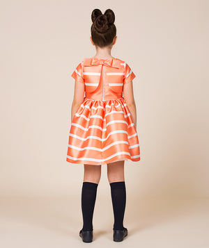 Back of girl in orange and white striped special occasion dress for kids
