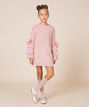 Girl in pink frilly designer dress for kids