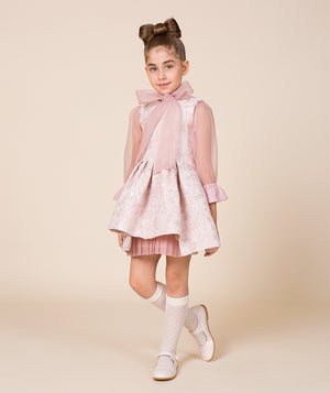 Girl in pink special occasion dress for kids with bow by Mama Luma