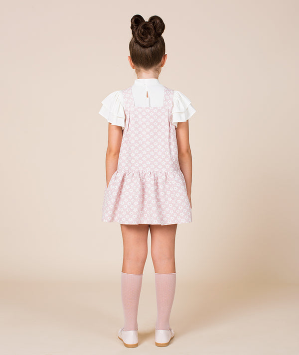 Back of girl in white ruffle blouse and pink daisy daisy dress for kids by Mama Luma