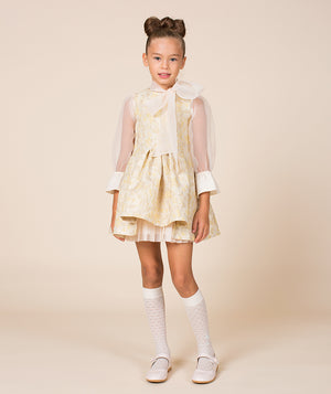 Girls in beige princess dress with bow by Mama Luma