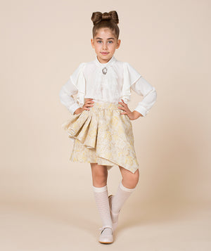 Girl in luxury outfit with white blouse and beige jacquard skirt for kids by Mama Luma