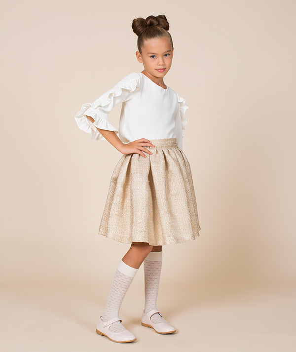 Girl in ruffle sleeve chic blouse for toddlers and beige flared skirt by Mama Luma