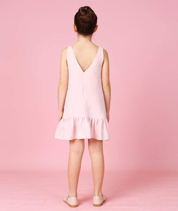 Back of girl in pink dress for kids