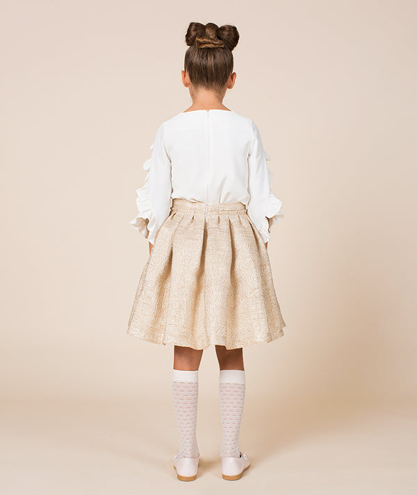 Back of girl in white blouse and beige skirt for kids by Mama Luma