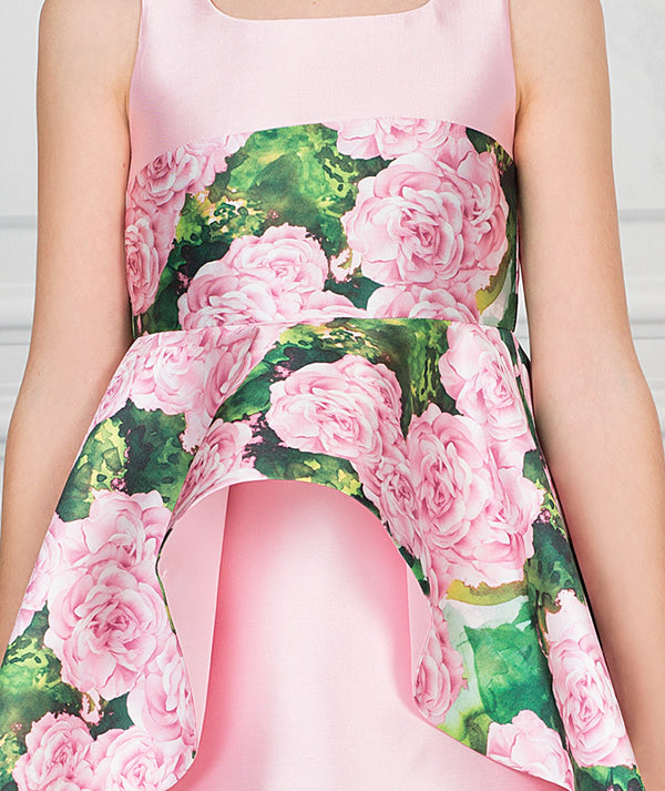 Girl in pink and green floral party dress for kids