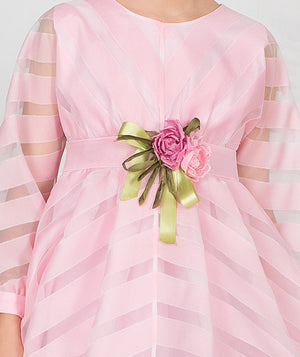 Girl in pink sheer and chiffon full length designer dress for kids with rose bouquet applique on waist by Mama Luma