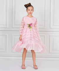 Girl in pink sheer and chiffon full length designer dress for kids with rose bouquet applique on waist for kids.
