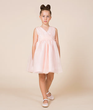 Girl in chic pink sheer dress for kids