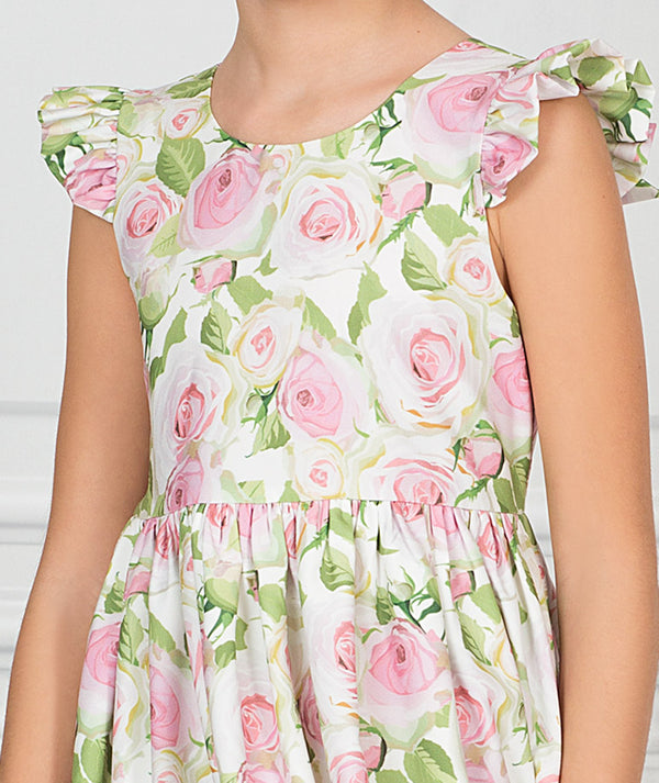 Girl in white, pink and green floral party dress for kids