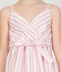 Girl in pink and white striped casual dress with a bow in the front for kids