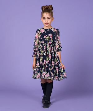 Girl in floral print dress for kids