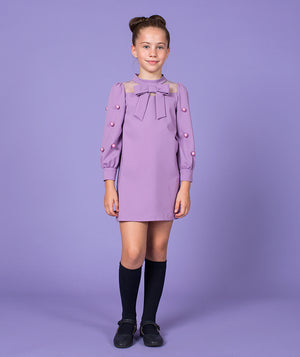 Girl in lilac party dress for kids with embellishments and bow by Mama Luma