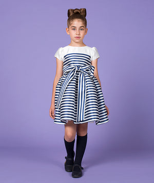 Girl in navy blue and white designer dress for kids