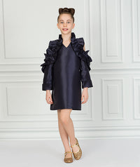 Girl in black ruffle party dress for kids.