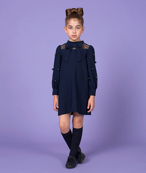 Girl in chic navy blue dress for kids