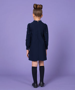 Back of girl in navy blue dress for kids
