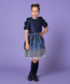 Girl in navy blue blouse and jacquard sheer skirt for kids by Mama Luma